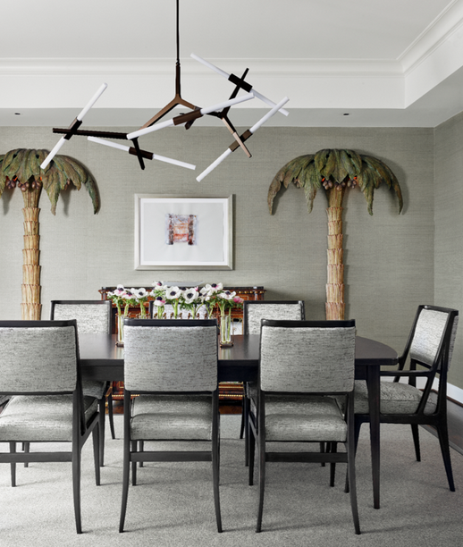 (7) In the dining room, Singer & Sons table and chairs, attributed to Gio Ponti and Bertha Schaefer. Lindsey Adelman Studio light fixture. Artwork Marilyn Baum. Vintage palm-tree floor lamps by Maison Jansen.