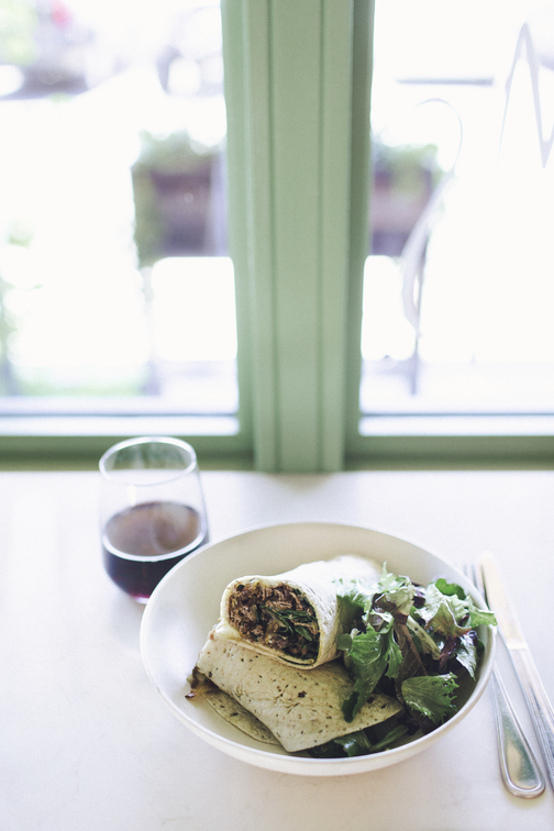 The Rebel wrap, with grass-fed steak, charred onion, port salut cheese, arugula, and horseradish yogurt
