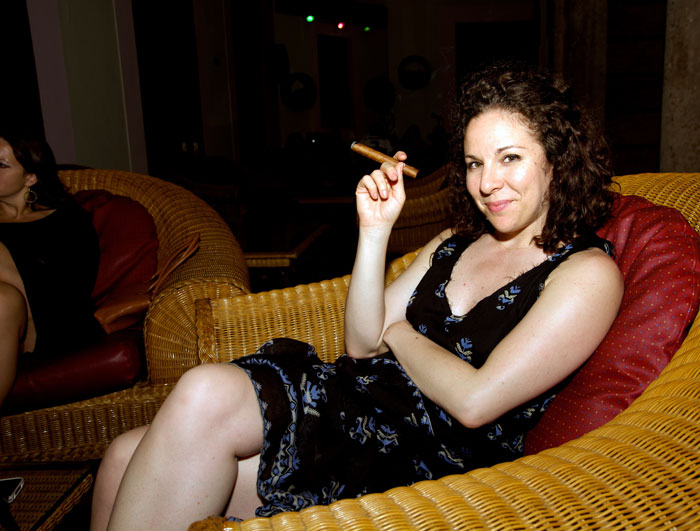 Erin Cluley tries a cigar at the Hotel Nacional.