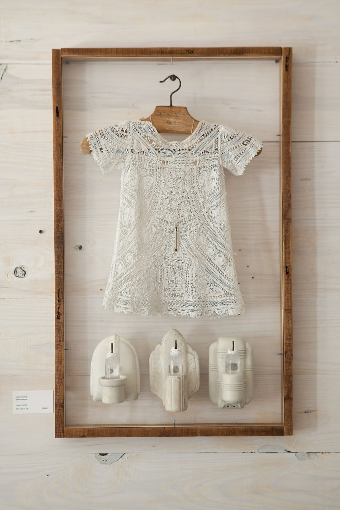 "The ethereal ""Three Wishes,"" 2013, combines an antique christening dress with a diminutive hanger from Hôtel Lotti, Paris. It was exhibited last fall in ""3"" at Cusack's long-time hometown dealer, Koelsch Gallery."