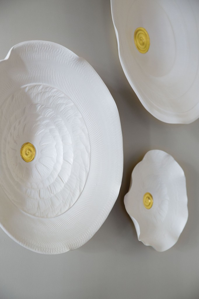 After installing a Lucrecia Waggoner installation in a project, Looke knew she wanted to start her own collection. This set of three porcelain pieces shine in the living room. At Laura Rathe Fine Art.