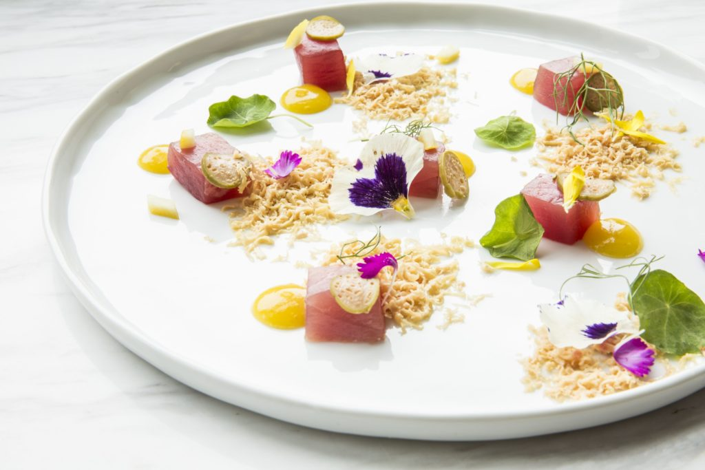 The ambition of Potente, Jim Crane's new restaurant, is clear in this tuna crudo with frozen foie gras, preserved lemon and caperberries dish.