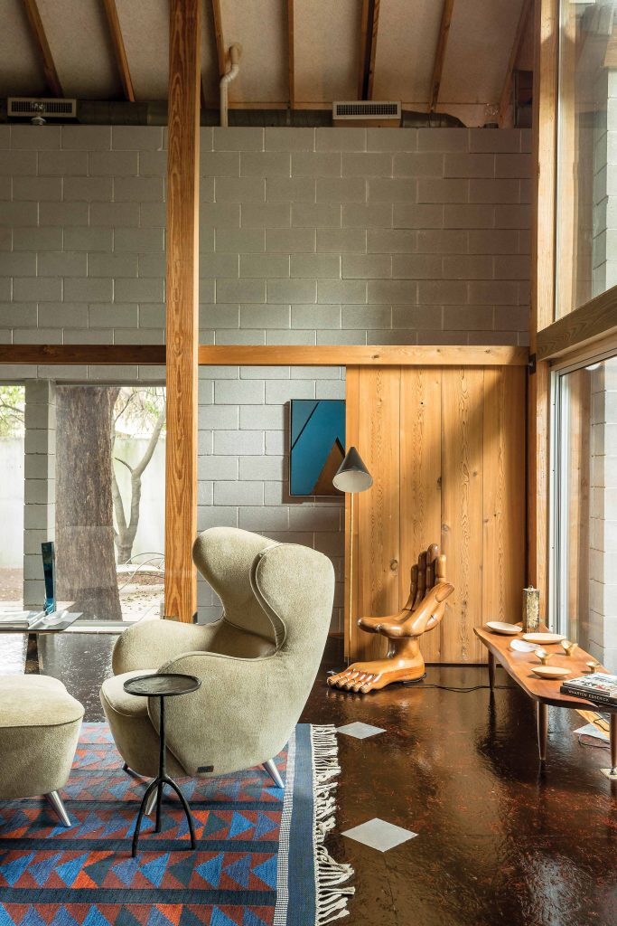 The living room's iconic seating, a Vladimir Kagan lounge chair and Pedro Friedeberg hand/foot chair.