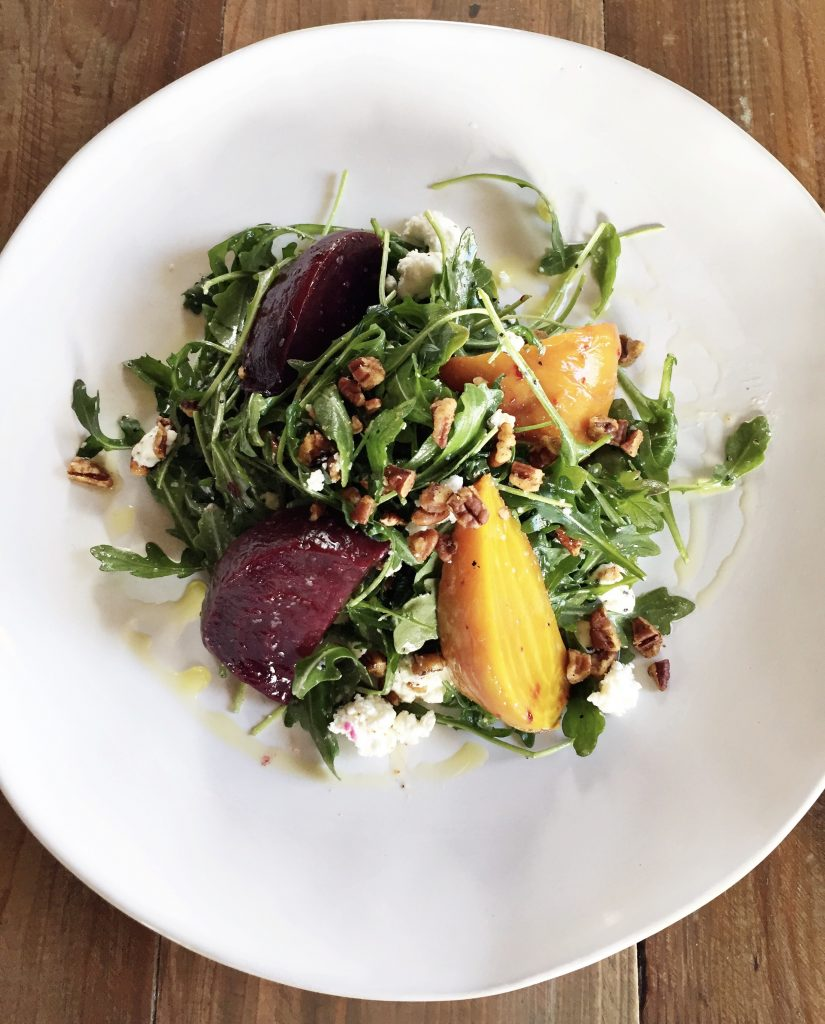 The roasted beets salad is topped with Texas pecans, chevre, olive oil, and sea salt.