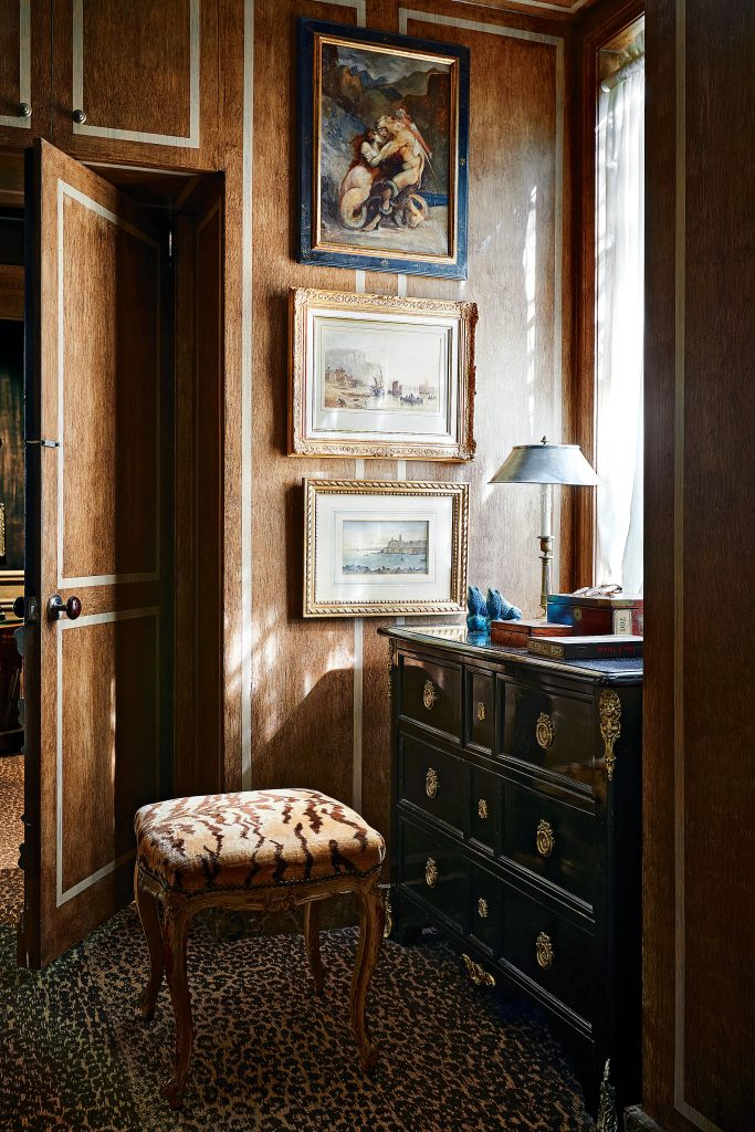 Kevin Peavy's dressing room with French 19th-century bench in Old World Weavers tiger velvet. Chest from Joseph Minton Antiques, 19th century.