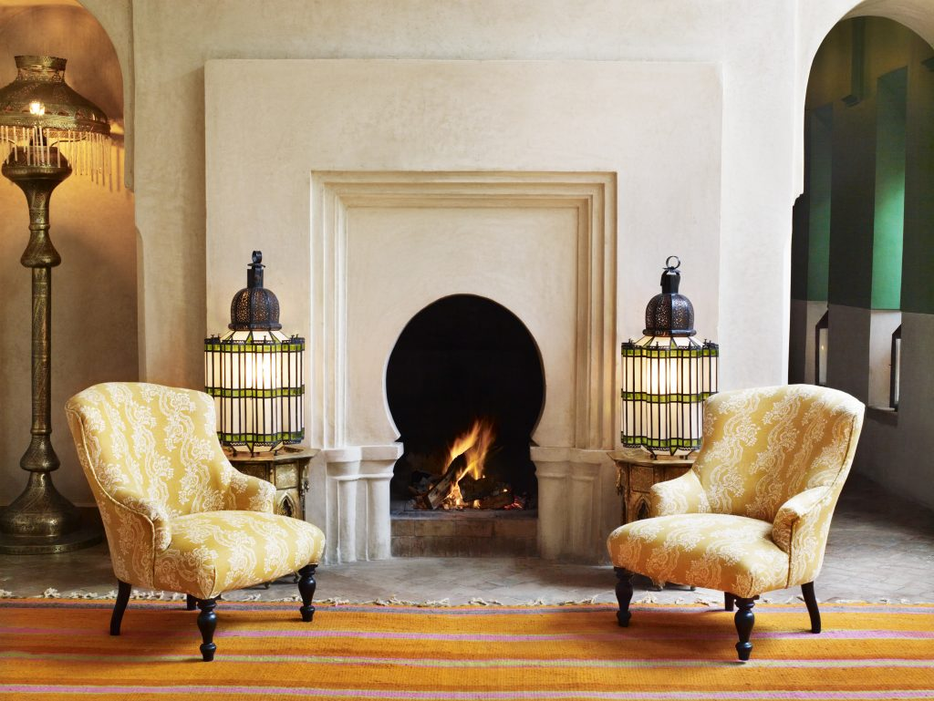 Bright orange and pink have never felt as soothing as they do next to this stunner of a fireplace