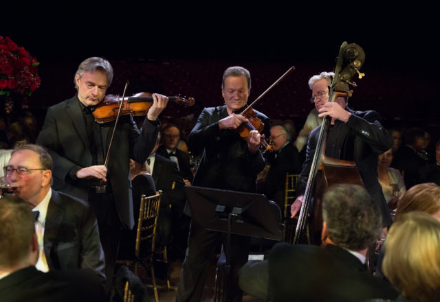 Orchestra musicians Sergei Galperin, Ferenc Illenyi, Michael Gorman perform at the Houston Symphony Wine Dinner in 2018. Performances been canceled due to COVID-19.