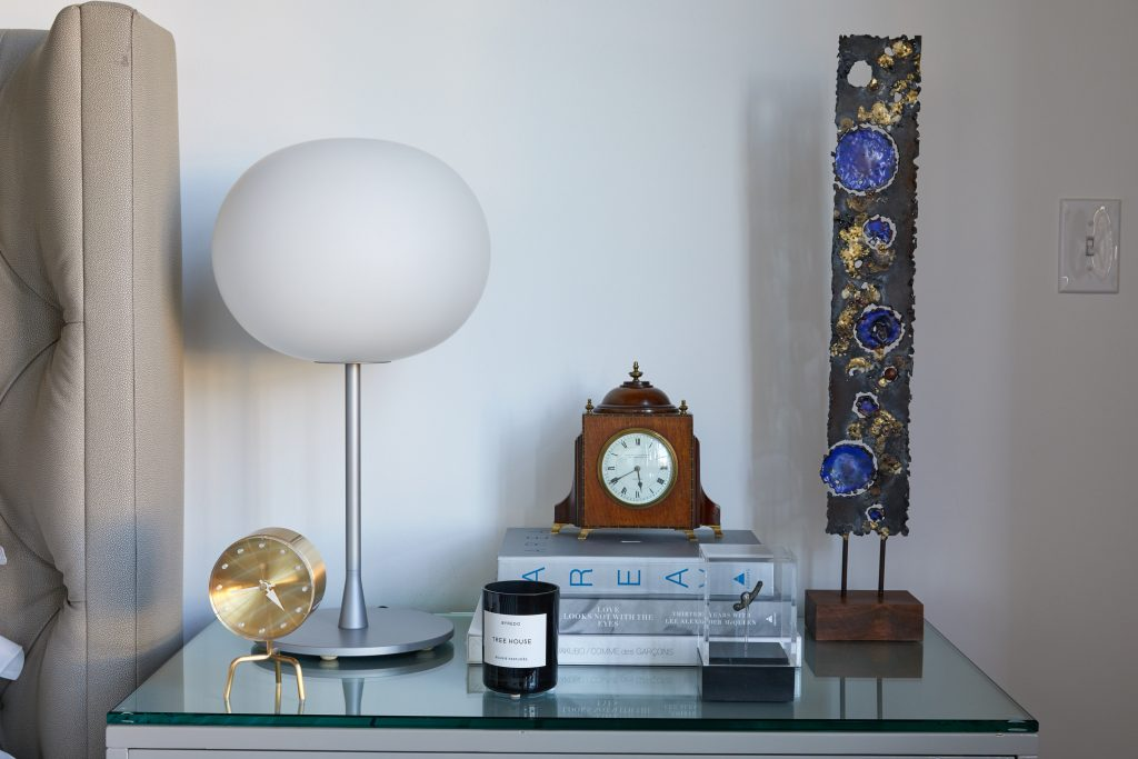 Jasper Morrison Glo Ball lamp for Flos. George Nelson Tripod clock for Vitra. Early-20th-century English mantel clock. James Bearden sculpture, circa 2007.