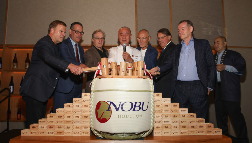 HOUSTON, TX - OCTOBER 18:  Nobu Founders Robert De Niro, Chef Nobu Matsuhisa, Meir Teper and friends break open a 5-gallon sake barrel at the Nobu Houston Sake Ceremony on October 18, 2018 in Houston, Texas.  (Photo by Rick Kern/Getty Images for Nobu)