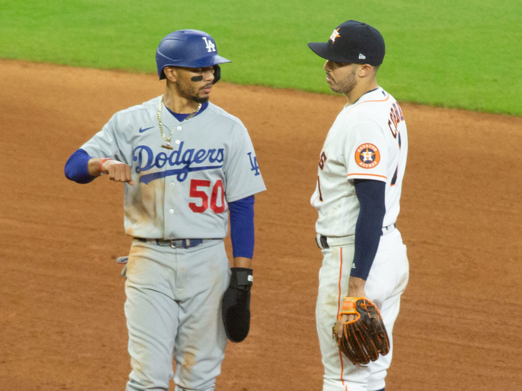 Los Angeles Dodgers Mookie Betts talks with Carlos Correa in the 7th inning after tempers flared up.