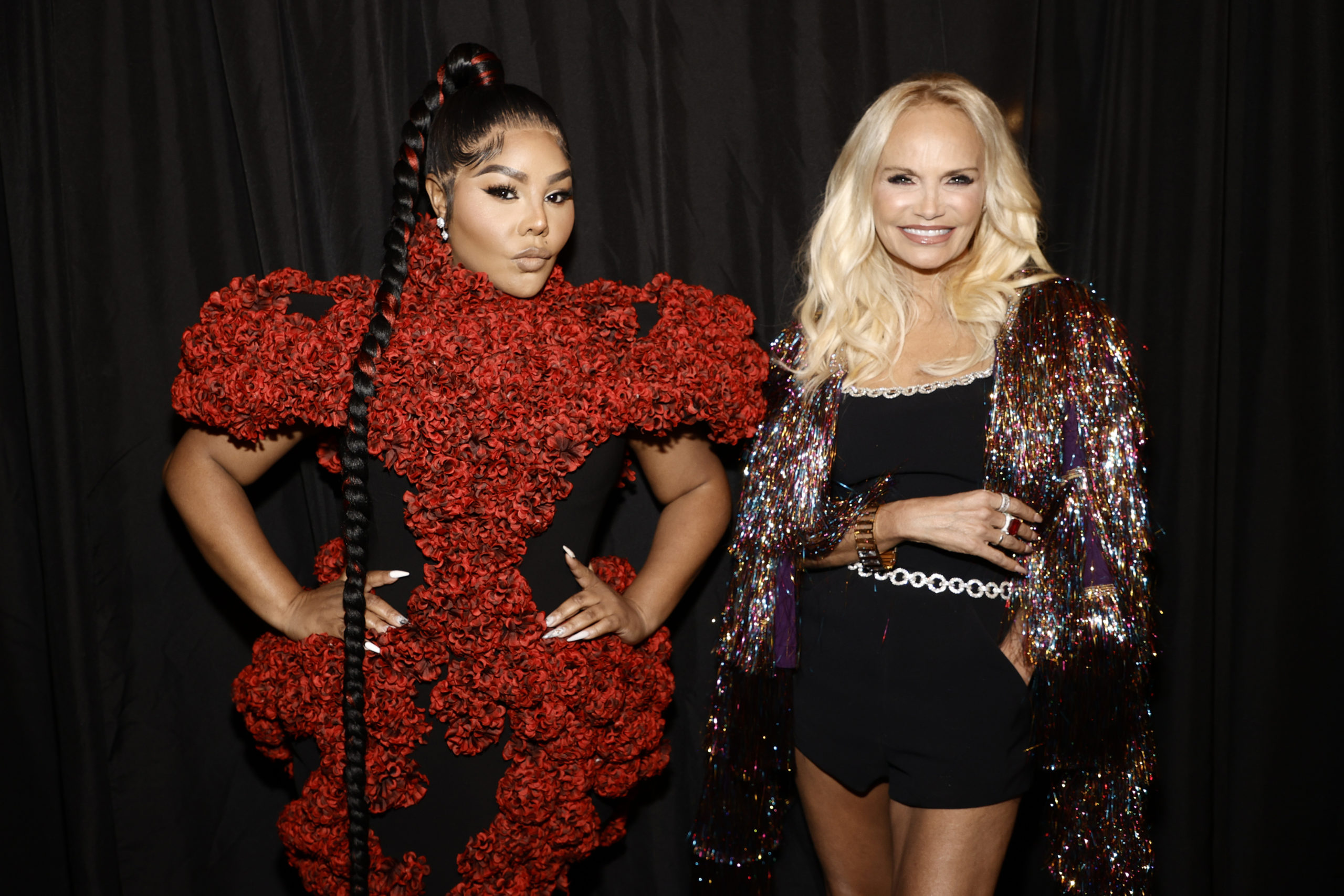 Lil 'Kim and Kristen Chenoweth at the Christian Siriano show
